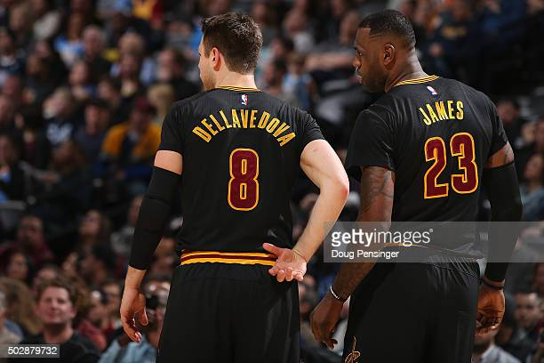 Matthew Dellavedova and LeBron James of the Cleveland Cavaliers talk during a break in the action against the Denver Nuggets at Pepsi Center on...