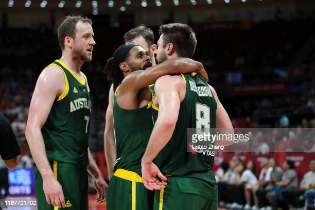 Matthew Dellavedova and Patty Mills of Australia reacts during the semi-finals of 2019 FIBA World Cup match between Spain and Australia at Beijing...