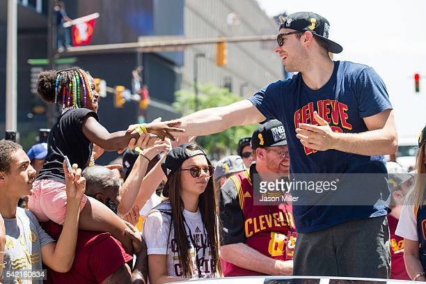 Matthew Dellavedova celebrates with fans during the Cleveland Cavaliers 2016 championship victory parade and rally on June 22 2016 in Cleveland Ohio