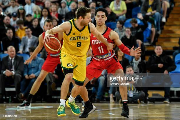 Matthew Dellavedova of Australia controls the ball against Andrew Nembhard of Canada during the International Basketball friendly match between the...