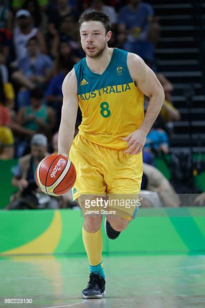 Matthew Dellavedova of Australia handles the ball during the Men's Semifinal match against Serbia on Day 14 of the Rio 2016 Olympic Games at Carioca...