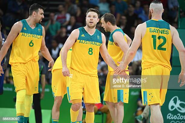 Matthew Dellavedova of Australia high fives Aron Baynes of Australia during the game against the USA Basketball Men's National Team on Day 5 of the...