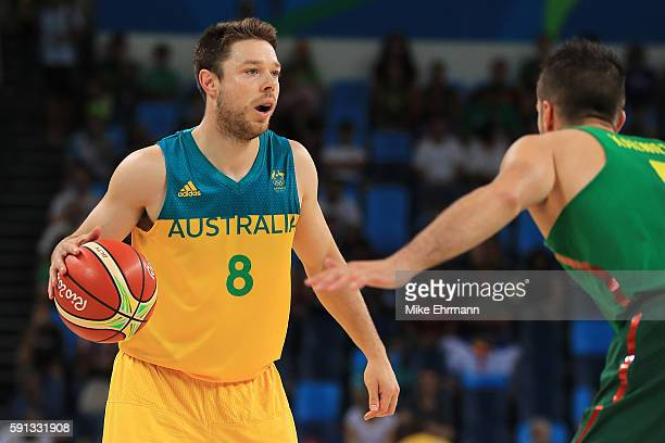 Matthew Dellavedova of Australia looks to drive the ball against Mantas Kalnietis of Lithuania during the Men's Quarterfinal match on Day 12 of the...