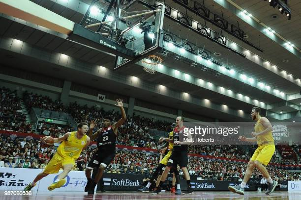 Matthew Dellavedova of Australia looks to pass the ball against Rui Hachimura of Japan during the FIBA World Cup Asian Qualifier Group B match...