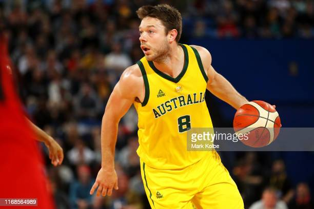 Matthew Dellavedova of Australia takes the ball down court during the International Basketball friendly match between the Australian Boomers and...