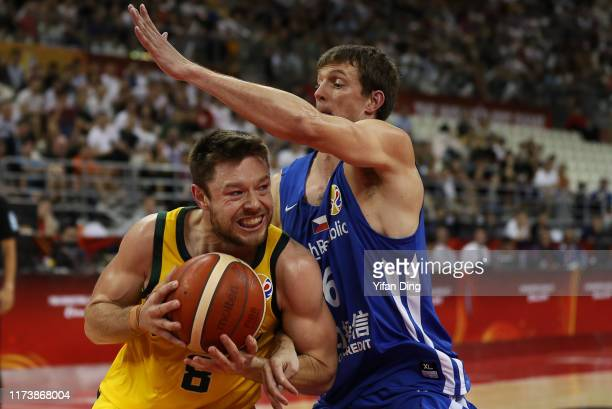 Matthew Dellavedova of Australia tries to make a shot against Pavel Pumprla of Czech Republic during the quarter final match between Australia and...