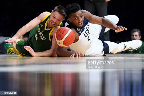 Matthew Dellavedova of the Boomers and Donovan Mitchell of the USA fight for the ball during the International Basketball Friendly match between the...