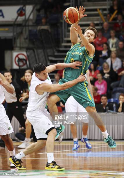Matthew Dellavedova of the Boomers and Jarrod Kenny of the Tall Blacks contest possession during the Men's FIBA Oceania Championship match between...
