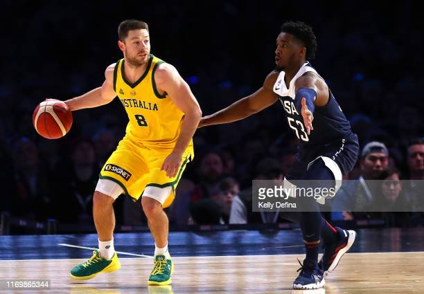 Matthew Dellavedova of the Boomers handles the ball under pressure from Donovan Mitchell of the USA during game two of the International Basketball...