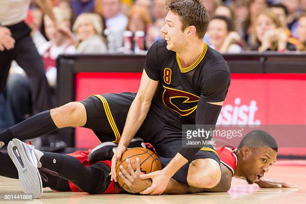 Matthew Dellavedova of the Cleveland Cavaliers and Damian Lillard of the Portland Trail Blazers fight for a loose ball during the first half at...