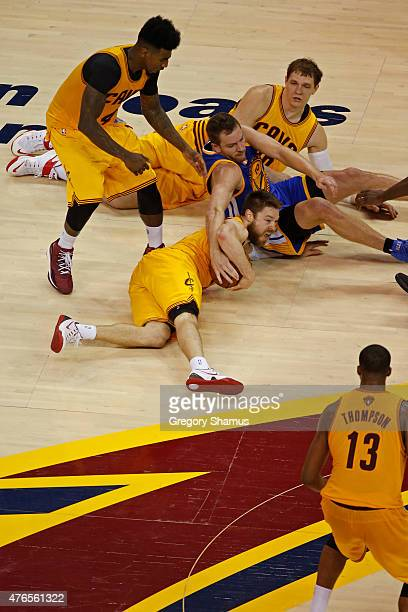 Matthew Dellavedova of the Cleveland Cavaliers dives for the loose ball against the Golden State Warriors during Game Three of the 2015 NBA Finals at...