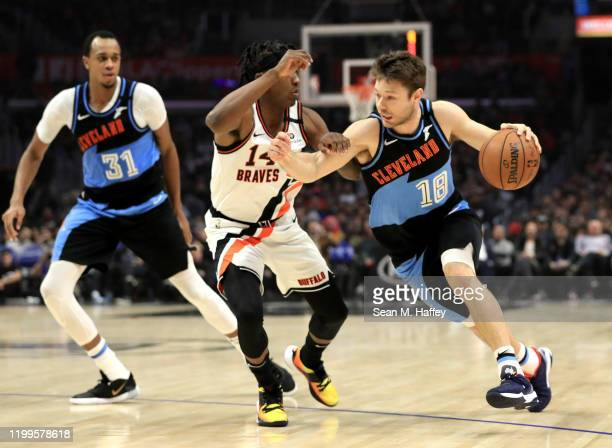 Matthew Dellavedova of the Cleveland Cavaliers dribbles past the defense of Terance Mann of the Los Angeles Clippers during the second half of a game...
