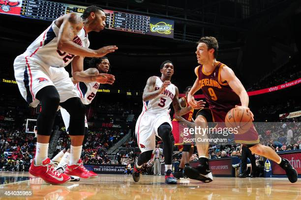 Matthew Dellavedova of the Cleveland Cavaliers drives to the basket against the Atlanta Hawks on December 6 2013 at Philips Arena in Atlanta Georgia...