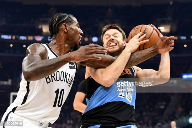 Matthew Dellavedova of the Cleveland Cavaliers fends off Iman Shumpert of the Brooklyn Nets during the first half at Rocket Mortgage Fieldhouse on...