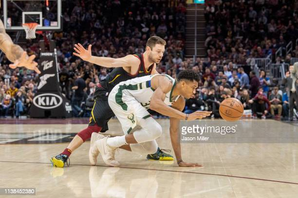 Matthew Dellavedova of the Cleveland Cavaliers fights Giannis Antetokounmpo of the Milwaukee Bucks for a loose ball during the second half at Quicken...