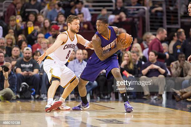 Matthew Dellavedova of the Cleveland Cavaliers guards Archie Goodwin of the Phoenix Suns during the first half at Quicken Loans Arena on March 7,...