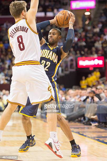 Matthew Dellavedova of the Cleveland Cavaliers guards C.J. Watson of the Indiana Pacers during the first half at Quicken Loans Arena on March 20,...