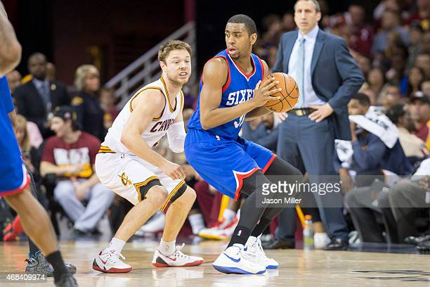 Matthew Dellavedova of the Cleveland Cavaliers guards Hollis Thompson of the Philadelphia 76ers during the second half at Quicken Loans Arena on...