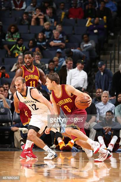 Matthew Dellavedova of the Cleveland Cavaliers handles the ball against the Memphis Grizzlies during the game on October 22 2014 at FedExForum in...