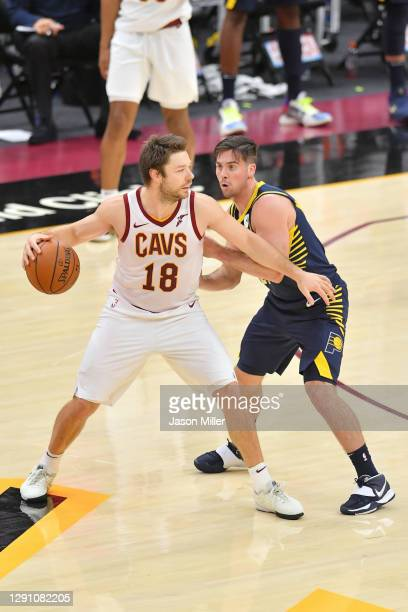 Matthew Dellavedova of the Cleveland Cavaliers looks for a pass around T.J. McConnell of the Indiana Pacers during the second half of a preseason...