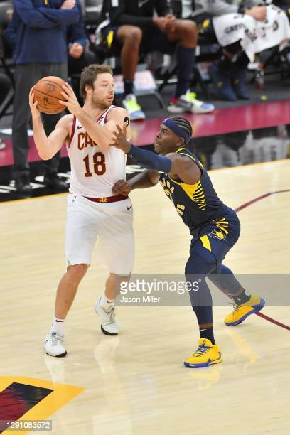 Matthew Dellavedova of the Cleveland Cavaliers looks for a pass while under pressure from Aaron Holiday of the Indiana Pacers during the second half...