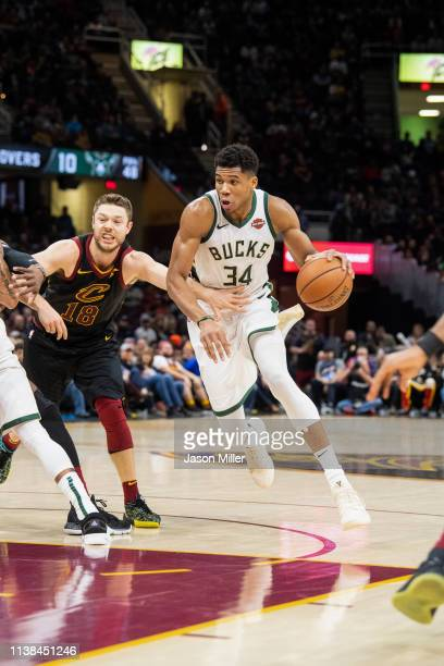 Matthew Dellavedova of the Cleveland Cavaliers puts pressure on Giannis Antetokounmpo of the Milwaukee Bucks during the second half at Quicken Loans...