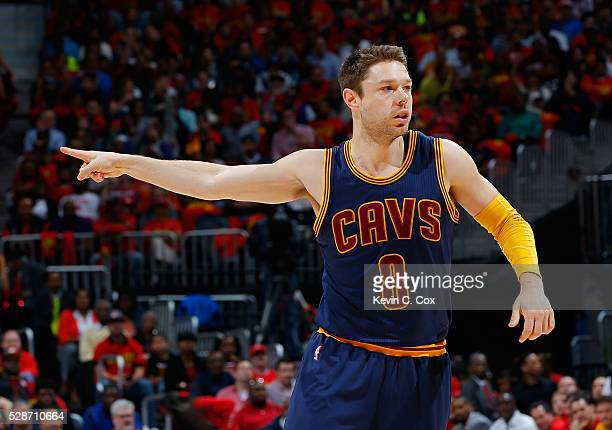 Matthew Dellavedova of the Cleveland Cavaliers reacts after hitting a threepoint basket against the Atlanta Hawks in Game Three of the Eastern...