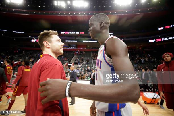 Matthew Dellavedova of the Cleveland Cavaliers shares a conversation with Thon Maker of the Detroit Pistons after the game on January 27, 2020 at...