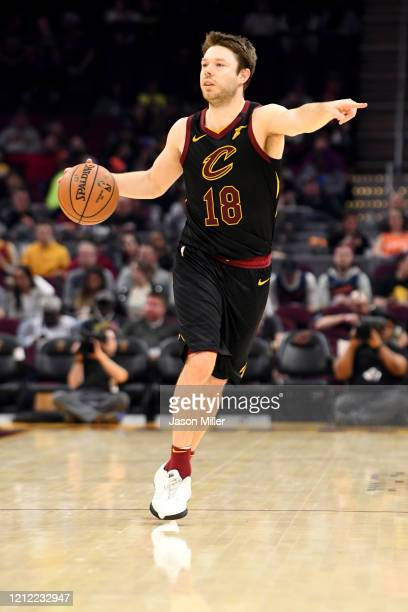 Matthew Dellavedova of the Cleveland Cavaliers signals to his teammates as he drives down court during the second half against the San Antonio Spurs...