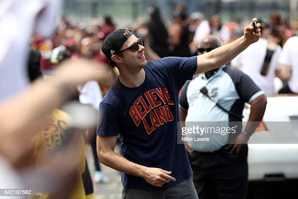 Matthew Dellavedova of the Cleveland Cavaliers takes photos with fans during the Cleveland Cavaliers 2016 NBA Championship victory parade and rally...