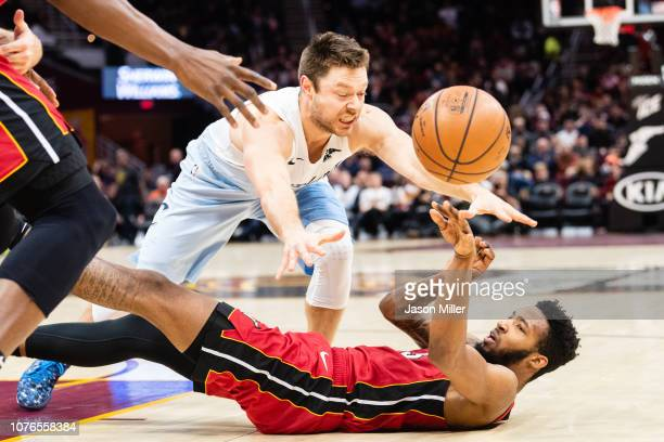 Matthew Dellavedova of the Cleveland Cavaliers tries to block Derrick Jones Jr #5 of the Miami Heat during the first half at Quicken Loans Arena on...