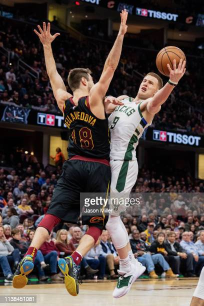 Matthew Dellavedova of the Cleveland Cavaliers tries to stop Donte DiVincenzo of the Milwaukee Bucks during the second half at Quicken Loans Arena on...