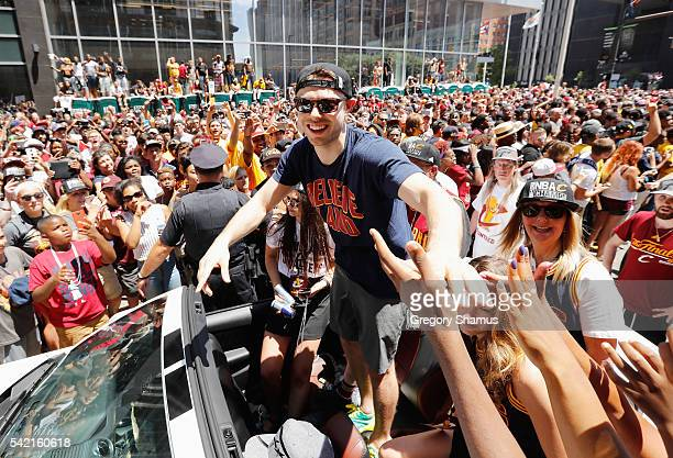 Matthew Dellavedova of the Cleveland Cavaliers waves at fans during the Cleveland Cavaliers Victory Parade And Rally on June 22 2016 in downtown...