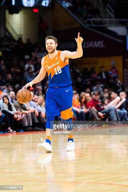 Matthew Dellavedova of the Cleveland Cavaliers yells to his players as he take the ball down court during the first half against the Brooklyn Nets at...