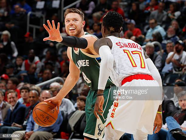 Matthew Dellavedova of the Milwaukee Bucks calls to his offense against Dennis Schroder of the Atlanta Hawks at Philips Arena on November 16 2016 in...