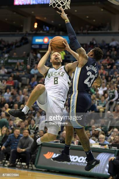 Matthew Dellavedova of the Milwaukee Bucks drives to the basket against Ben McLemore of the Memphis Grizzlies during the first half of a game at the...