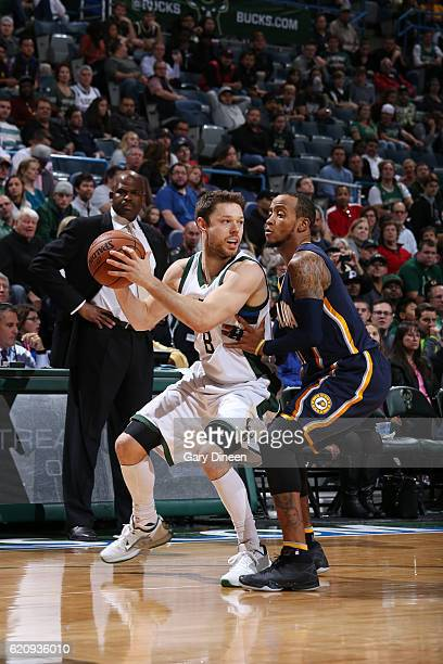 Matthew Dellavedova of the Milwaukee Bucks handles the ball against Monta Ellis of the Indiana Pacers during a game on November 3 2016 at the BMO...
