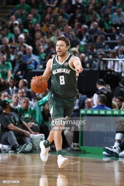 Matthew Dellavedova of the Milwaukee Bucks handles the ball against the Boston Celtics on October 18 2017 at the TD Garden in Boston Massachusetts...