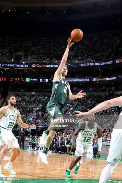 Matthew Dellavedova of the Milwaukee Bucks rebounds the ball during the game against the Boston Celtics on October 18 2017 at the TD Garden in Boston...