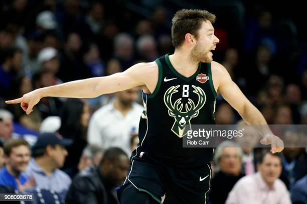 Matthew Dellavedova of the Milwaukee Bucks runs down the floor after scoring against the Philadelphia 76ers in the first half at Wells Fargo Center...