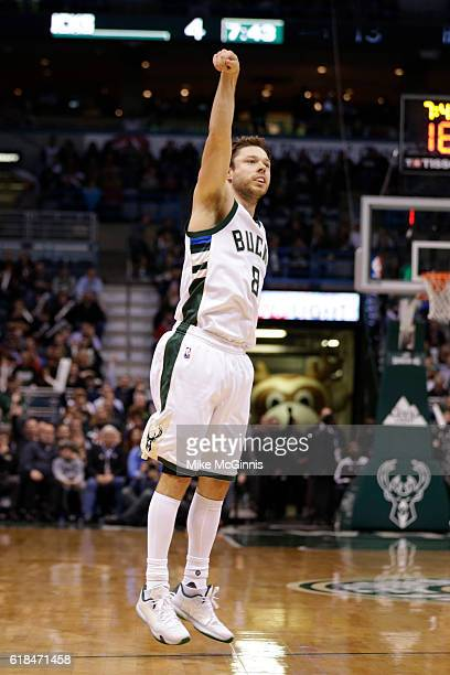Matthew Dellavedova of the Milwaukee Bucks shoots a three pointer during the first quarter against the Charlotte Hornets at BMO Harris Bradley Center...