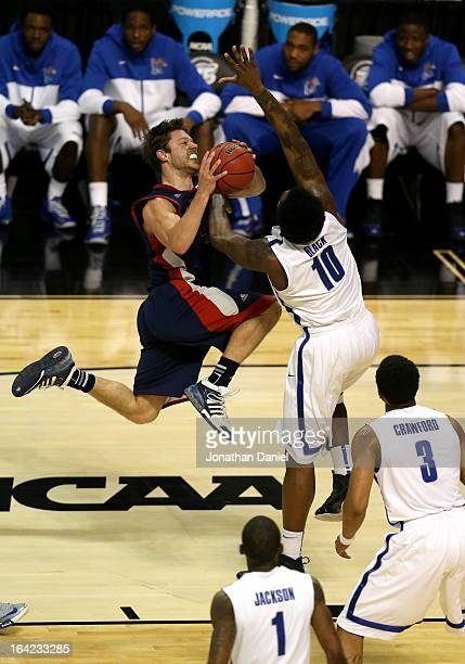 Matthew Dellavedova of the St Mary's Gaels drives for a shot attempt against Tarik Black and Geron Johnson of the Memphis Tigers during the second...