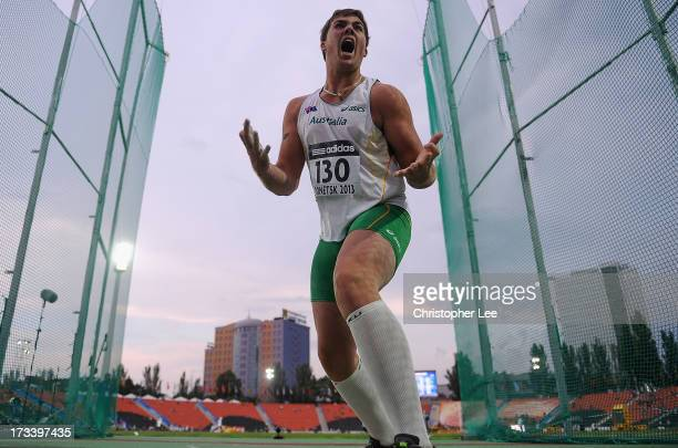 Matthew Denny of Australia celebrates scoring a World Youth Lead score and his personal best winning him the gold medal in the Boys Discus Throw...