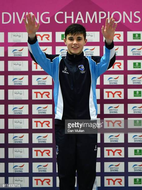 Matthew Dixon of Plymouth Diving Club celebrates on the podium following victory in the Mens 10m Platform Final on day three of the British Diving...