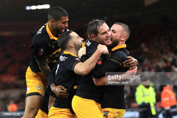 Matthew Dolan of Newport County celebrates with teammates after scoring his team's first goal during the FA Cup Fourth Round match between...
