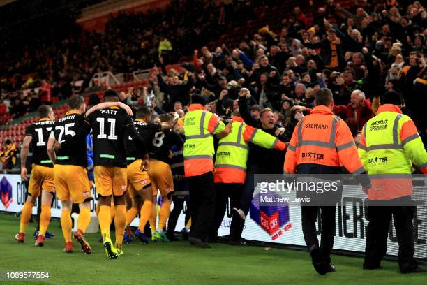 Matthew Dolan of Newport County celebrates with teammates and their fans after scoring his team's first goal during the FA Cup Fourth Round match...