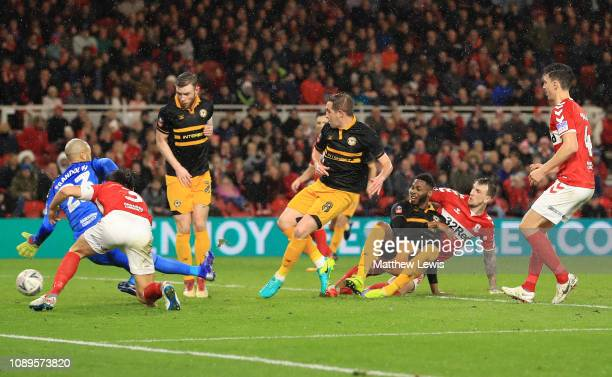 Matthew Dolan of Newport County scores his team's first goal during the FA Cup Fourth Round match between Middlesbrough and Newport County AFC at...