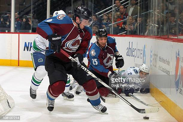 Matthew Duchene of the Colorado Avalanche controls the puck against the Vancouver Canucks after Chris Stewart of the Avalanche put a hit on Dan...