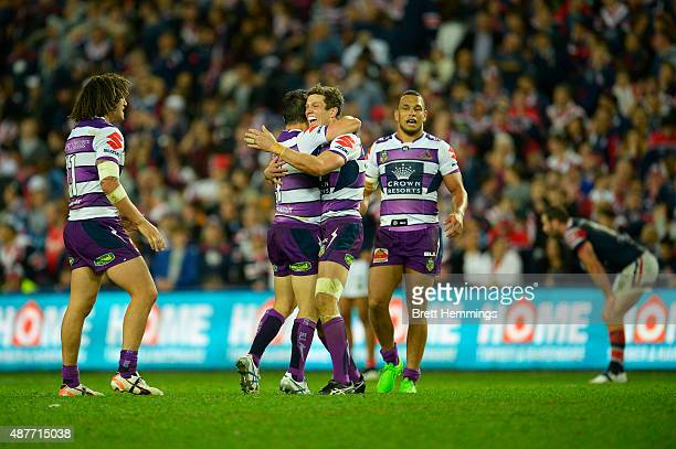 Matthew Duffie celebrates victory with Cooper Cronk of the Storm during the NRL qualifying final match between the Sydney Roosters and the Melbourne...