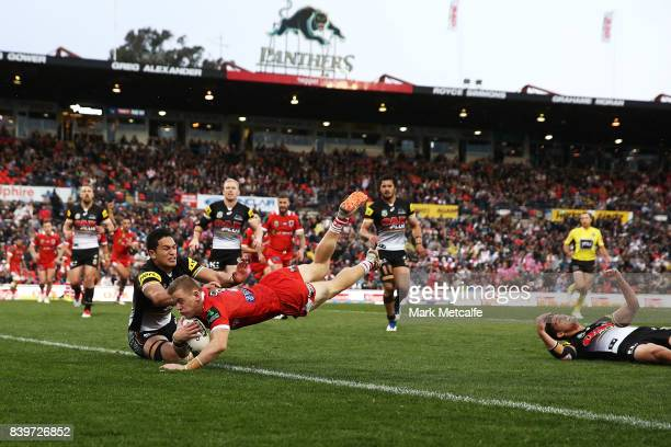 Matthew Dufty of the Dragons scores a try during the round 25 NRL match between the Penrith Panthers and the St George Illawarra Dragons at Pepper...